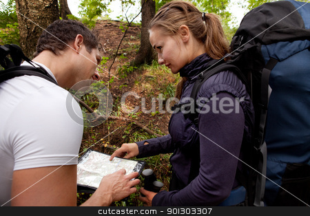 Lost with Map stock photo, A coupld with map and compass in the forest - lost by Tyler Olson