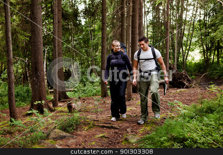 Camping Hike Couple stock photo, A couple on a hiking camping trip in the forest by Tyler Olson