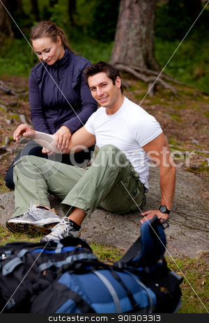 Arm Bandage First Aid stock photo, A woman applying an arm bandage on a male camper - focus on male face by Tyler Olson