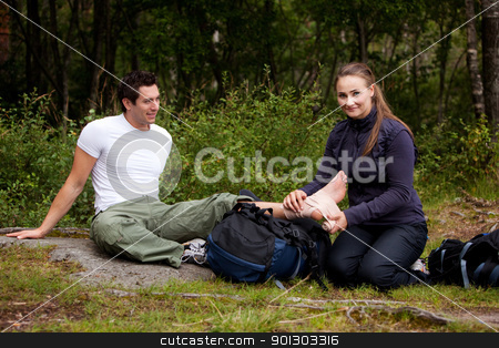 Camping First Aid stock photo, A couple camping and putting on a leg bandage by Tyler Olson