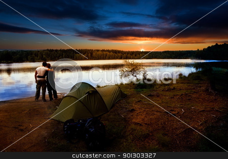 Camping Lake Sunset stock photo, A pair of campers with a tent set against a beautiful sunset lake landscape by Tyler Olson