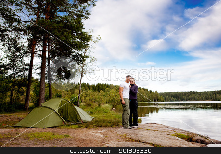 Camping by Lake stock photo, A couple of happy campers by a lake and forest by Tyler Olson