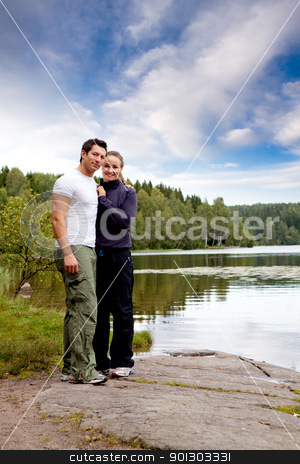 Outdoor Couple Portrait stock photo, A outdoors couple portrait by a lake and forest by Tyler Olson