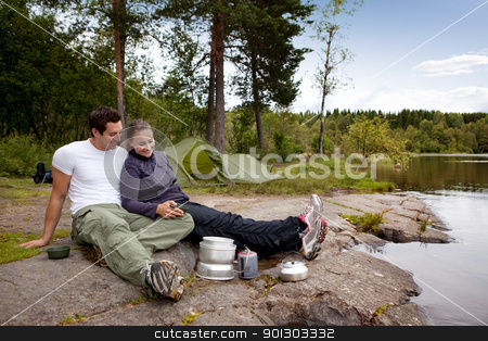 Outdoor Camping Food stock photo, A couple camping and eating outdoors by Tyler Olson