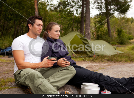 Outdoor Couple stock photo, A couple sitting enjoying eachothers company while camping by Tyler Olson