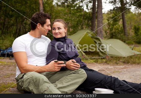 Happy Couple stock photo, A happy couple outdoors on a camping trip by Tyler Olson