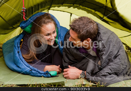 Camping stock photo, A happy couple in a tent looking at each other by Tyler Olson