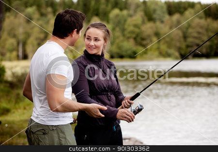 Woman Fishing stock photo, A woman fishing - showing a man by Tyler Olson