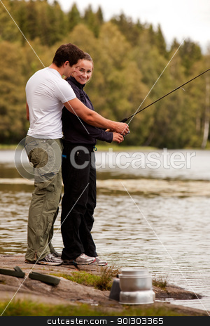 Man and Woman Fishing stock photo, A man and woman fishing on a forest lake by Tyler Olson