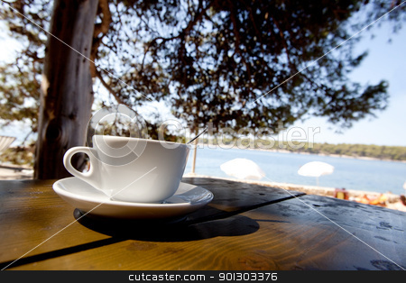 Outdoor Cafe by Beach stock photo, A coffee cup in an outdoor cafe  by Tyler Olson