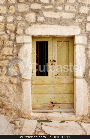 Old Wooden Door stock photo, An old wooden door in a stone building by Tyler Olson