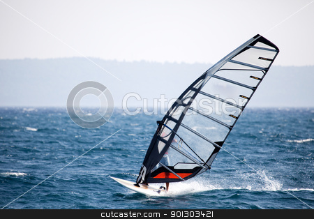Wind Surfing stock photo, A wind surfer on the ocean by Tyler Olson