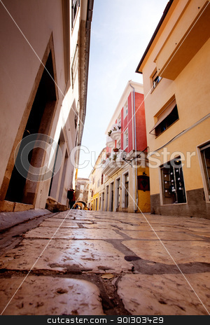 Cobblestone Road stock photo, A small pretty street wtih cobblestone in Rab, Croatia by Tyler Olson