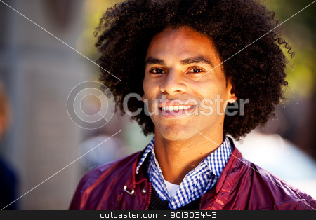 Happy Man stock photo, A happy young adult - African American in an urban setting by Tyler Olson