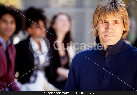 Friends Man stock photo, A portrait of a young man and a group of friends by Tyler Olson