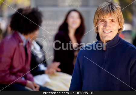 Friends stock photo, A portrait of a young man and a group of friends by Tyler Olson