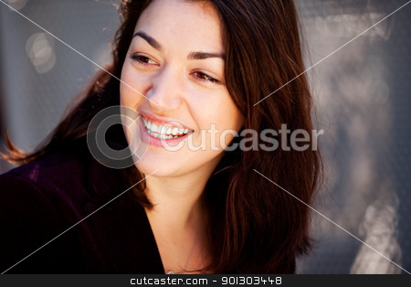 Candid Happy Woman stock photo, A candid portrait of a happy young woman in an urban setting by Tyler Olson