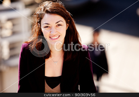 Candid Woman Portrait stock photo, A candid portrait of a young woman in the city by Tyler Olson