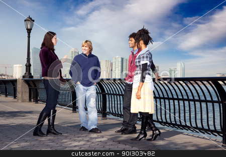 City Friends stock photo, A group of friends on a city walk way by the water by Tyler Olson