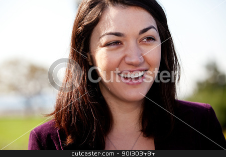 Happy Girl stock photo, A candid portrait of a happy girl outside in a park by Tyler Olson