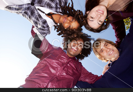 Group Hug stock photo, A group of friends hugging and looking down on the camera by Tyler Olson