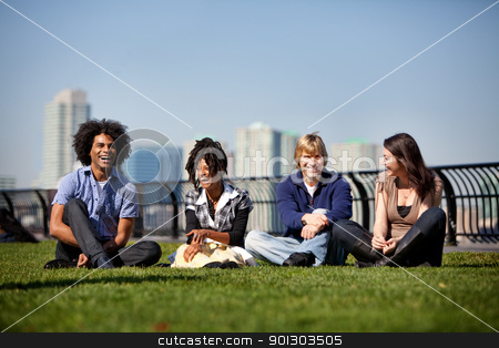 City Park Friends stock photo, A group of friends in a city park talking and laughing by Tyler Olson
