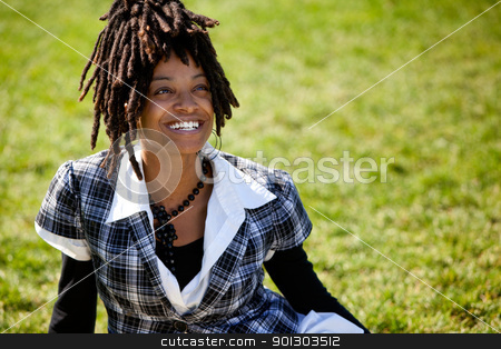 African American Woman stock photo, An attractive African American woman with a candid smile by Tyler Olson