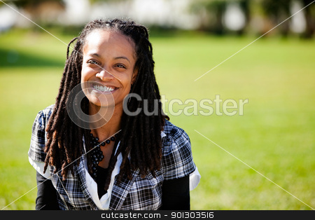 Beautiful Smile Woman stock photo, A beautiful African American with candid smile by Tyler Olson
