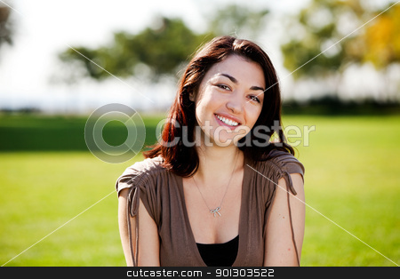 Happy Student stock photo, A happy young student outside in a park by Tyler Olson