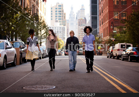 Young People in City stock photo, A group of young adults in an uban setting - walking on a road by Tyler Olson