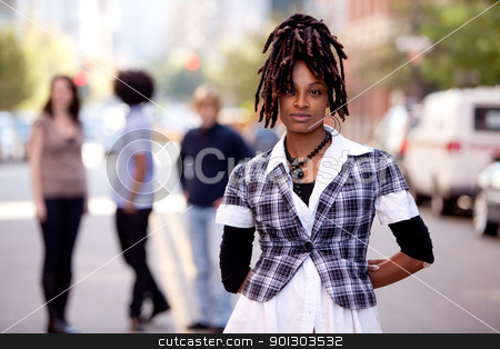 Beautiful African American stock photo, A beautiful african american woman in a city setting with friends by Tyler Olson