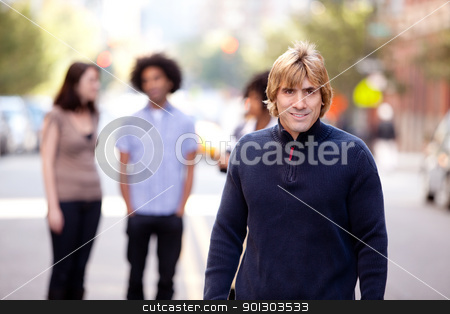 Urban People City stock photo, A group of people in a city setting - a caucasian male in the foreground by Tyler Olson