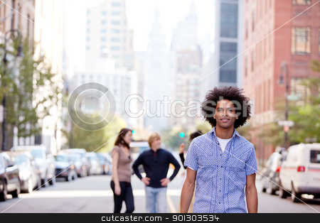 City People stock photo, A city setting with a group of friends, a happy African American in the foreground by Tyler Olson