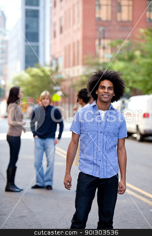 Urban Man stock photo, A young adult in a city setting with friends by Tyler Olson