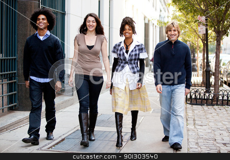 Urban Lifestyle stock photo, A group of friends walking on the sidewalk in an urban setting by Tyler Olson