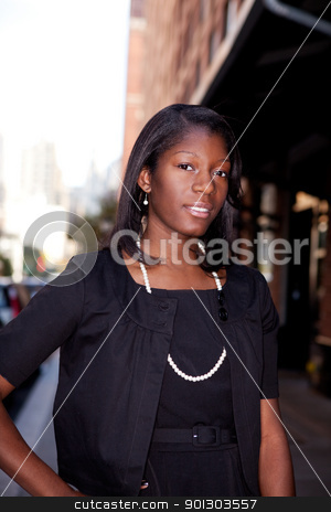 Business Woman stock photo, An African American business woman in an urban setting. by Tyler Olson