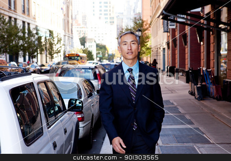 Business Man stock photo, A business man in a city setting on a sidewalk by Tyler Olson