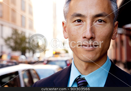 Confident Business Man stock photo, A successful business man in a street setting by Tyler Olson