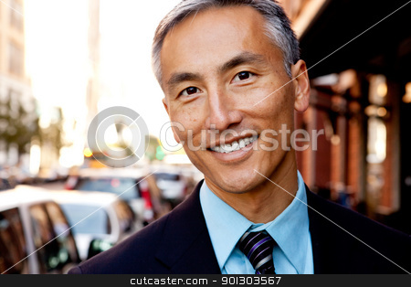 Business Man Portrait stock photo, A portrait of a happy asian looking business man by Tyler Olson
