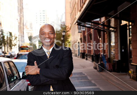 Happy Business Man stock photo, A happy business man on a street in a city by Tyler Olson