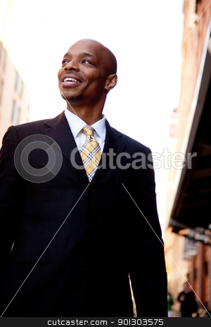 Business Man Street stock photo, A street portrait of a business man walking on a sidewalk by Tyler Olson