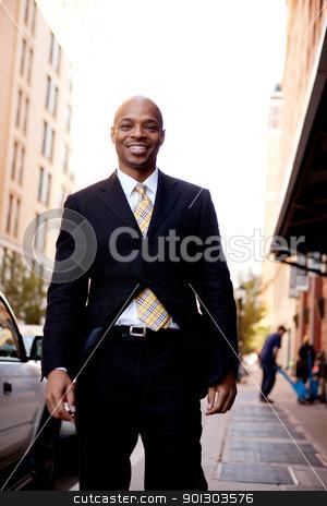 Business Man Street Portrait stock photo, A street portrait of a business man walking on a sidewalk by Tyler Olson