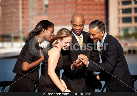 Cell Phone Business stock photo, A group of business people crowded around a cell phone by Tyler Olson