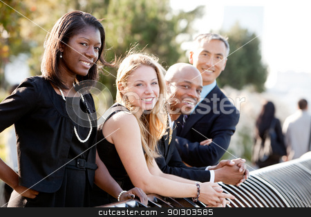 Business Team stock photo, A business team outside - sharp focus on front woman by Tyler Olson