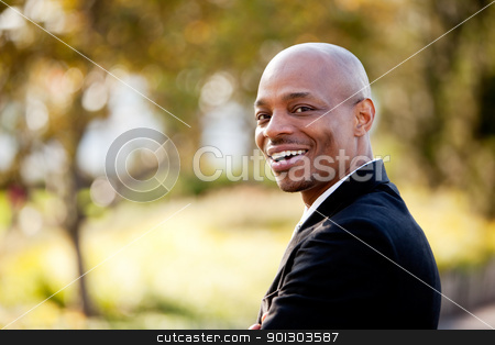 Big Smile Business Man stock photo, An African American business man with a big smile by Tyler Olson