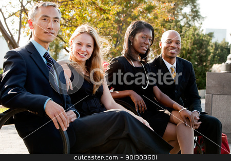 Business Team stock photo, A multicultural business team on a bench in a park by Tyler Olson