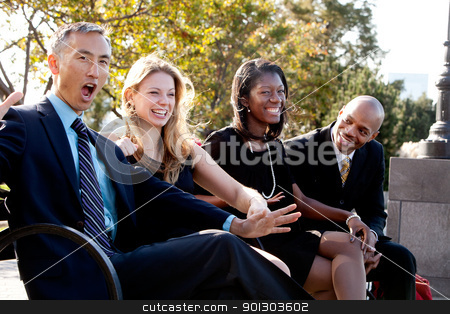Fun Business Joke stock photo, A group of business people having fun and joking by Tyler Olson