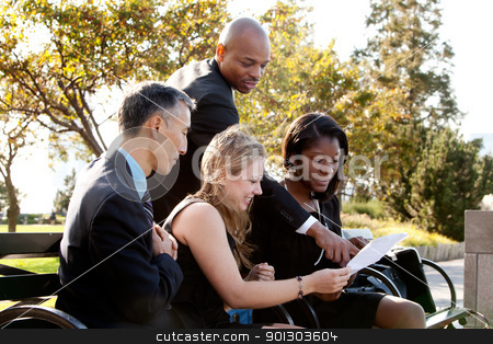 Business in Park stock photo, A group of business people in a park setting by Tyler Olson