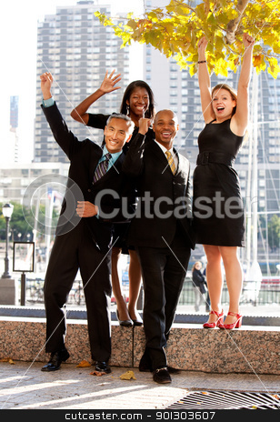 Success stock photo, A business team celebrating success by Tyler Olson