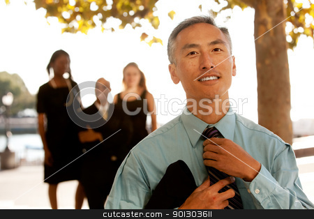 Casual Business Portrait stock photo, A cansual asian business man adjusting his tie by Tyler Olson